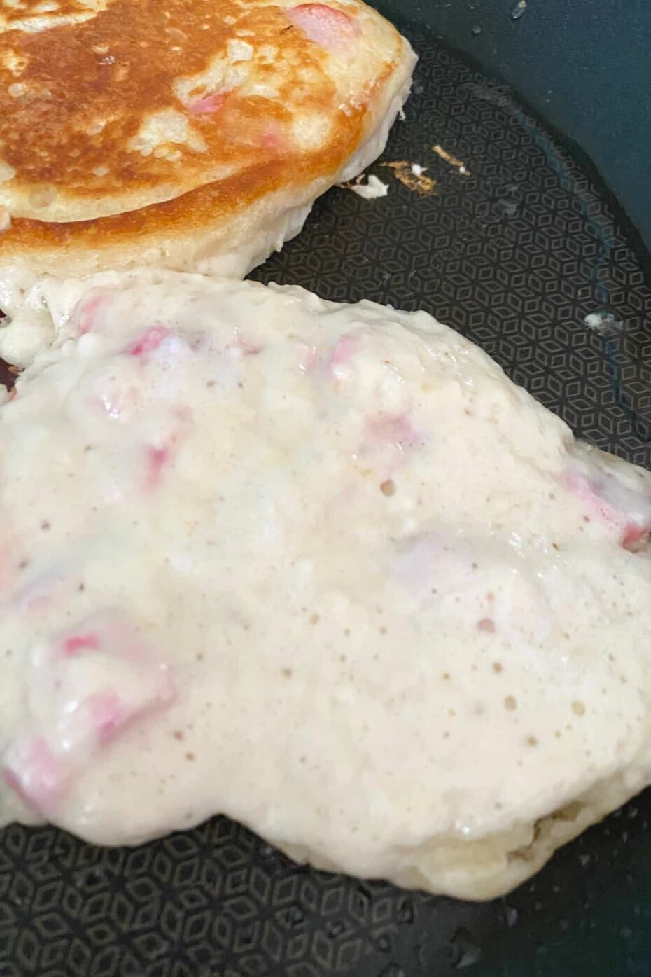 Fluffy Rhubarb Pancakes, showing bubbles in pancake