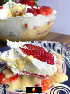 Easy Strawberry and Lemon Trifle, quick simple dessert recipe with layers of fresh strawberries, lemon whipped cream, vanilla pudding and lady's fingers. Great for parties and holidays