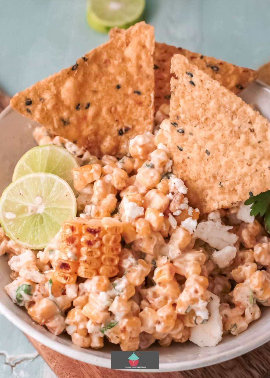 Mexican Street Corn Dip, a traditional street food, serve warm or cold, with tortilla chips or with tacos. An easy dip recipe made of fresh corn, creamy mayo, and sour cream, a splash of lime, and Mexican Cotija cheese. The best ever dip you'll eat!